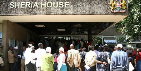 People queue outside Sheria House in Nairobi.