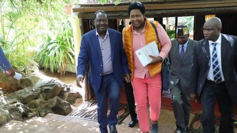 ODM party leader Raila Odinga (l) and Narok Senator Ledama ole Kina walk out of the delegates conference held in Narok on Friday, February 21, 2020.