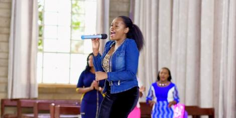 Gospel musician Betty Bayo performing in Church.