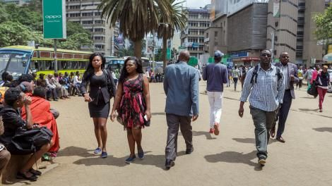 File image of Kenyans pictured walking in the capital, Nairobi