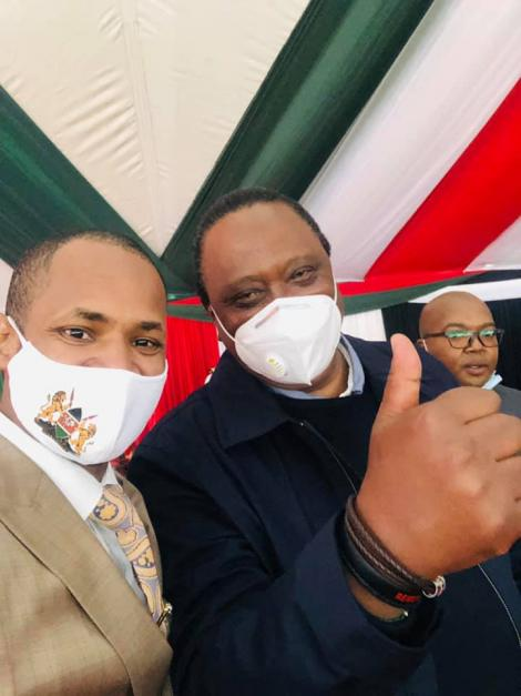President Uhuru Kenyatta and Embakasi East MP Paul Ongili aka Babu Owino take a selfie on Friday, August 21, at KICC, Nairobi.