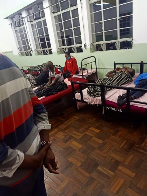 Quarantined individuals at the Kenya High School sleeping close to each other.