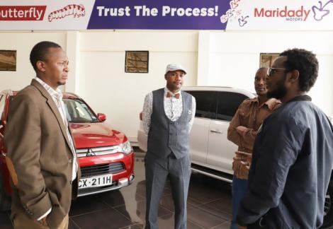 Michael Njogo Gitonga interacts with staff at Maridadi Motors on Wednesday, August 12, 2020.