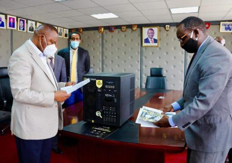 DCI Director Geroge Kinoti reads through the Talino forensics workstation manual on April 28, 2020.