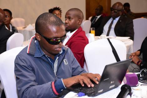 Computer programmer Anthony Wambua using his laptop