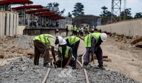 Workers working on the Embakasi line