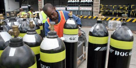 A worker inspecting Boc Gas cylinders