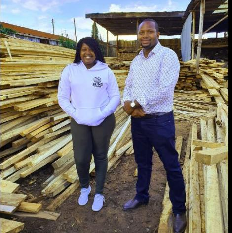Linnet Kathambi poses with Makiga Homes Director James Ruhiu during his visit to Sung Timber.