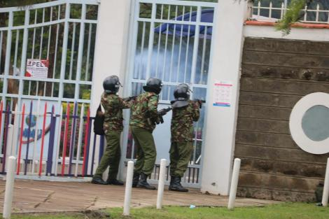Anti-riot police lob teargas at the Multi Media University students on Friday, November 20.
