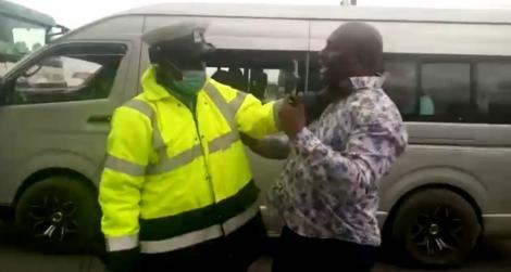 An image of a police officer assaulting a motorist