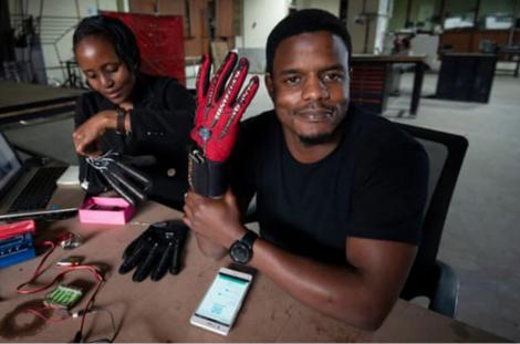 Roy Allela, displays the smart hand gloves which he invented.