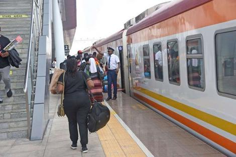 Passengers travel to Mombasa using a Madaraka Express train at the Nairobi terminus in Syokimau.