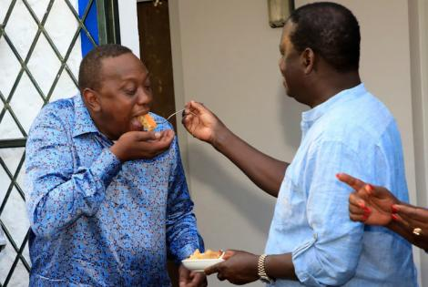 ODM leader Raila Odinga shares his birthday cake with President Uhuru Kenyatta at his home in Mombasa on January 7, 2019