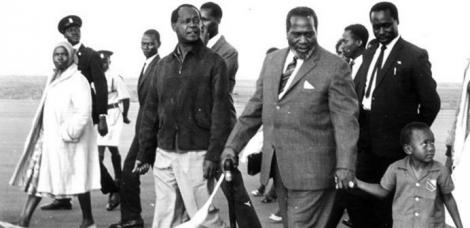 Former President Mzee Jomo Kenyatta (centre) with a young Uhuru Kenyatta, Vice President Moi (behind him) and former Attorney General Charles Njonjo (to Mzee Jomo's right) in the mid 1960s..jpg