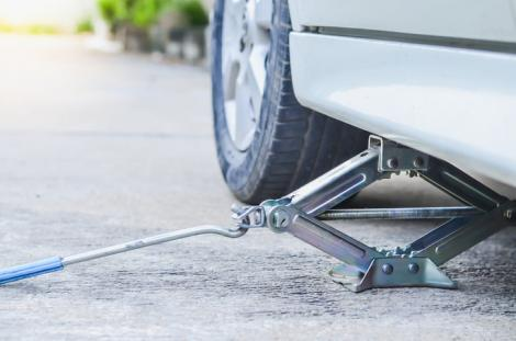 File image showing a car on a jack.