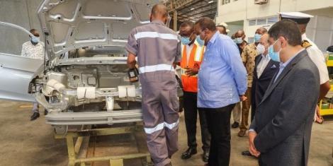 President Uhuru Kenyatta commissions local assembly of Proton Saga saloon cars on Thursday, December 10
