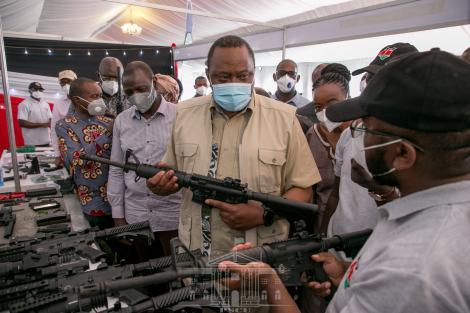 President Uhuru Kenyatta holding the CMZ 4 Assault Rifle made in Kenya at the KWS Law Enforcement Academy in Manyani, Taita Taveta County on October 16, 2020