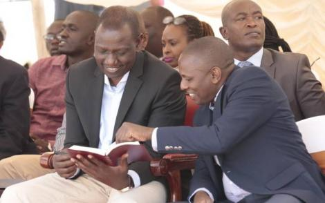 Deputy President William Ruto (left) and Kikuyu MP Kimani Ichung'wah during a past church service at PCEA Church in Mwiki on March 3, 2019