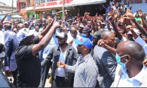 DP William Ruto (in black shirt) with Embakasi West MP George Theuri (in hat) during a public event in March 2021.