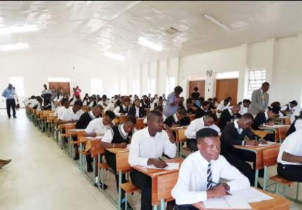 An image of Teachers in a classroom with students in a secondary school