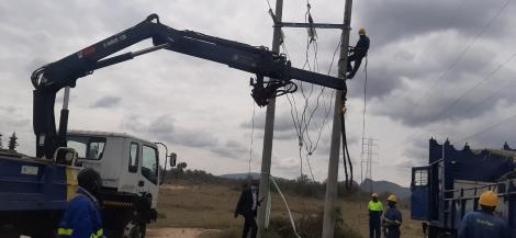 Kenya Power workers working on power lines at Soysambu Conservancy on February 22, 2021
