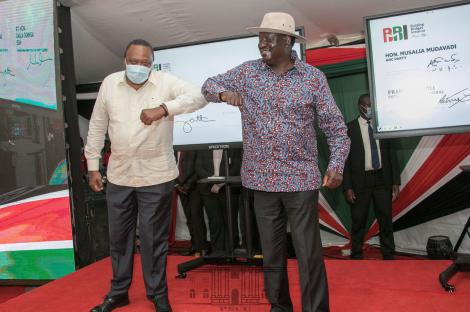 President Uhuru Kenyatta (Left) and Raila Odinga at the KICC in Nairobi for the National launch of the BBI signature collection exercise.  November 25, 2020.