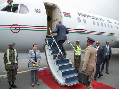President Uhuru Kenyatta boarding a plane