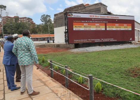 President Uhuru Kenyatta (in green shirt) and former Prime Minister Raila Odinga shown bus schedule at Green Park Terminus