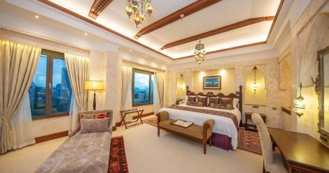 A bedroom at the Serena Hotel Presidential Suite