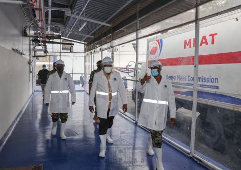 President Uhuru Kenyatta (Center) during a tour of Kenya Meat Commission Landhies Deport on Monday, May 24, 2021.