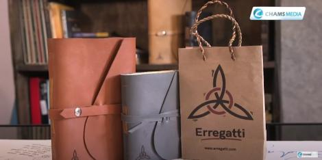 Photo of two handmade leather journals and an Erregatti packaging bag taken on May 31, 2021, from the Erregatti workplace in Nairobi.