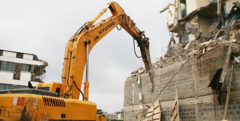 A bulldozer demolishes a house in Eastleigh in 2011
