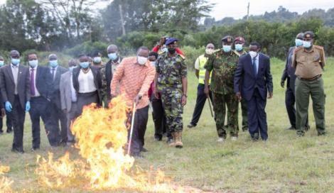 President Uhuru Kenyatta sets 5,144 guns ablaze at the Regional Police Traffic Training Centre in Ngong, Kajiado County.