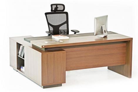 An iMac on a desk inside an office