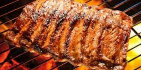 an image of nyama choma on a grill