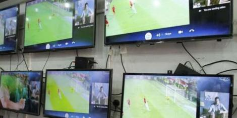 An image of television sets displayed in an electronics shop