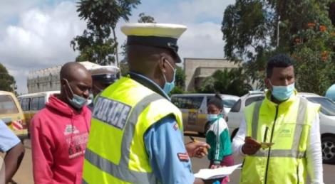 A police officer engages a motorist during the NTSA crackdown on Tuesday, May 4, 2021.