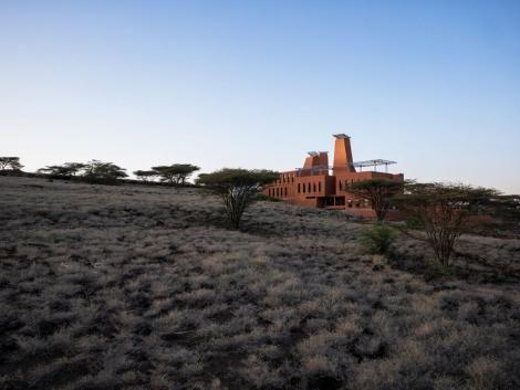 It occupies a sloped site beside Lake Turkana