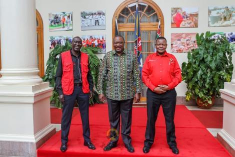 From left; Jubilee party Kiambaa MP candidate Kariri Njama, President Uhuru Kenyatta and Muguga ward MCA aspirant Githinji Mungara