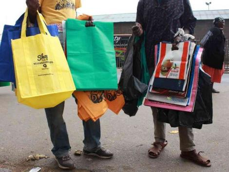 Traders display the required woven carrier bags.
