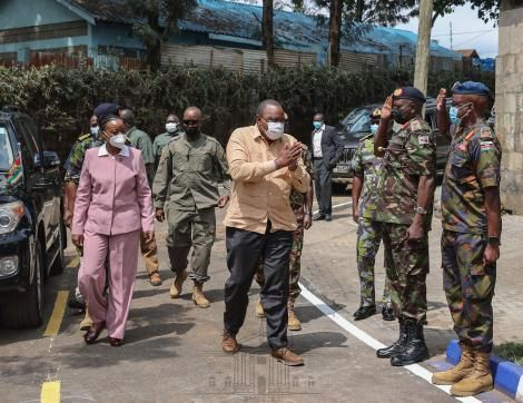 President Uhuru Kenyatta (in brown shirt) with Defence CS Monica Juma arrive at Kenya Meat Commission (KMC) Landhies Road deport on Monday, May 24, 2021.