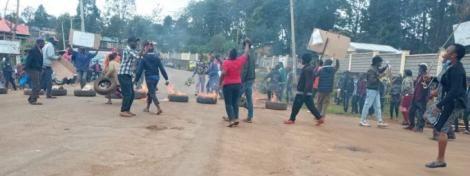 Embu resident light bonfires during a protest