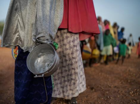 Women and children lining up for relief food in 2019.