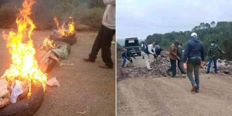 Kenyans light bonfires along a road in Kieni