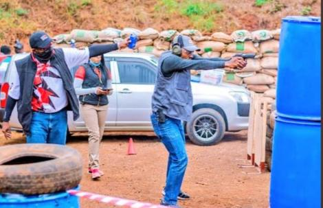 A Kenyan Shooter in Action During the Competition.