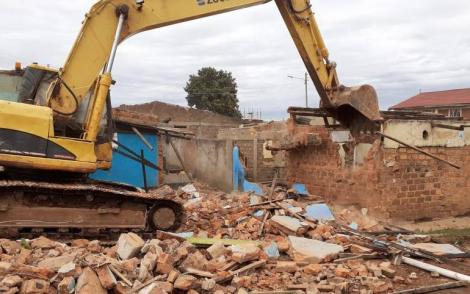 A bulldozer demolishes the home of the mother of former nominated MP Catherine Nyamato on Saturday, May 23, 2020, in Nyamira.