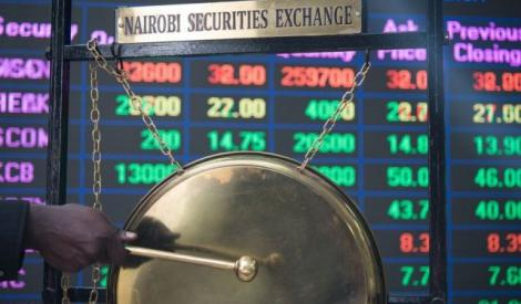 Person rings the bell on the floor of Nairobi Stock Exchange (NSE)