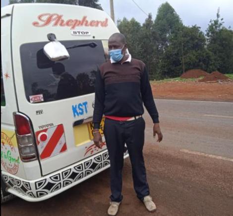 Matatu Driver Basilio Kimani Strikes a Pose Next to his Matatu.