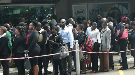 Hundreds of youth queue during an open employment drive by a city hotel on Saturday, May 26, 2018