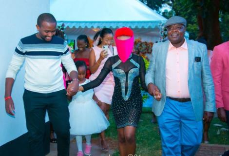Billionaire Andrew Ngirici (right), his daughter Tanya (in red hair) and guests during the party